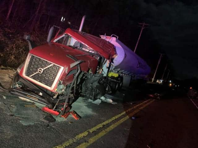 Police are looking for answers in a deadly head-on collision that entrapped a trucker.
