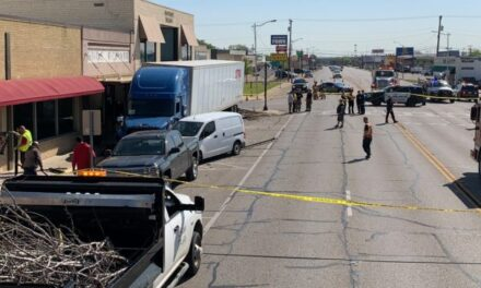 VIDEO: During a medical emergency, a trucker plows into parked vehicles and almost hits a barbershop.