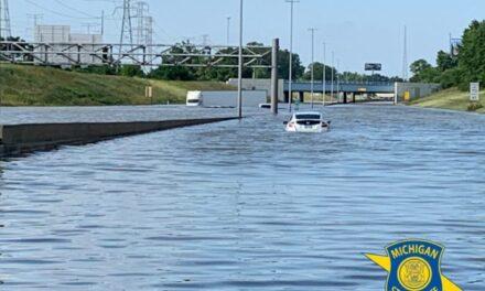 Flood waters left dozens of Semi Trucks stranded on I-94 in Detroit